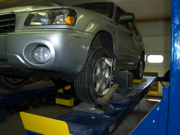 Alignment, studded tires, tire studding, tire changes, tire repair, auto repair, suspension repair, brake repair, exhaust repair, transmission replacement, engine replacement, oil change