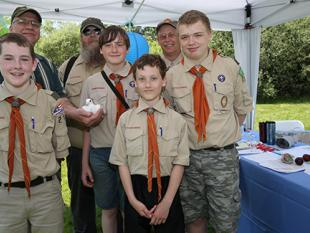 Boy Scout Troop 215 of Thomaston assist Marc Archambault, owner of White Doves of Maine in Washington Maine, with the release of two white doves.