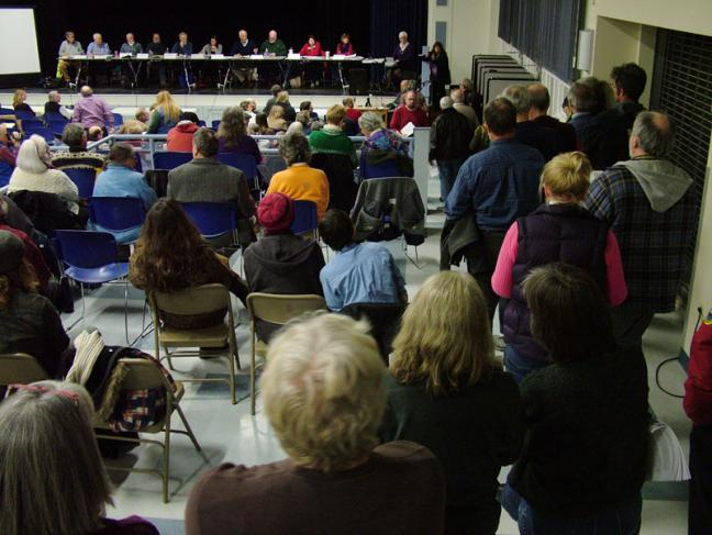 Roughly 40 citizens lined up to address the Planning Board during the final public hearing on a controversial propane terminal proposed for construction in Searsport. (Photo by Ethan Andrews)